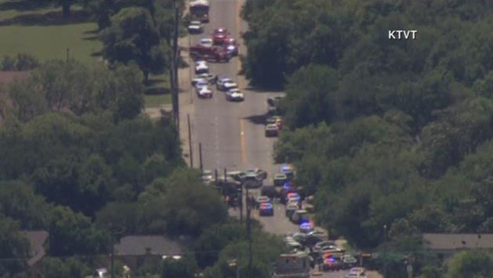 Massive police presence in the area of a shooting that wounded a Dallas Fire-Rescue paramedic. The scene remains active. (Source: KTVT/CNN)