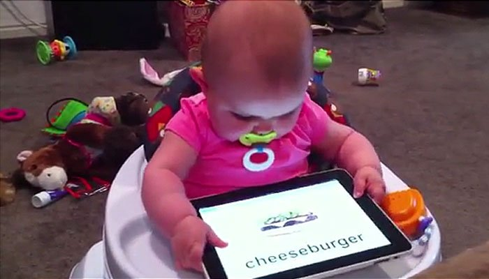 A new study links babies' screen time with their using sounds and words. (Source: CNN)