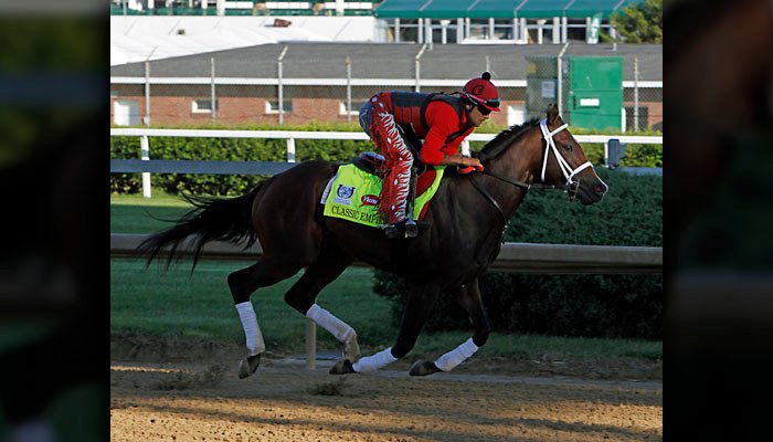 Kentucky Derby hopeful Classic Empire, ridden by exercise rider Martin Rivera, gallops at Churchill Downs in Louisville, Ky., Tuesday, May 2, 2017. The 143rd running of the Kentucky Derby is Saturday, May 6.(AP Photo/Garry Jones)