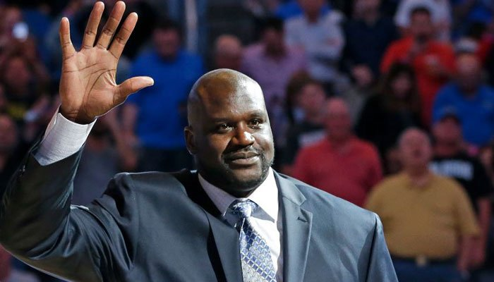 Former NBA star Shaquille O'Neal waves to fans as he is honored during a game between the Orlando Magic and the Detroit Pistons after he was inducted in the Magic Hall of Fame, Friday, March 27, 2015. (Source: AP Photo/John Raoux)