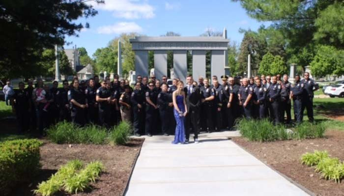 Dozens of officers showed up to take prom pictures with Sierra Bradway. (Source: Indianapolis Police Department)