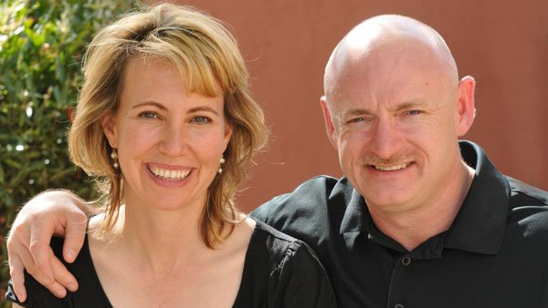 Rep. Gabby Giffords, D-AZ, smiles alongside her husband, astronaut Mark Kelly. (Source: Giffords for Congress)