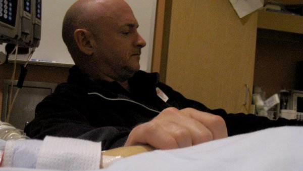 Astronaut Mark Kelly, husband of Rep. Gabrielle Giffords, D-AZ, keeps vigil at his wife's bedside at the University Medical Center. (Source: KOLD)