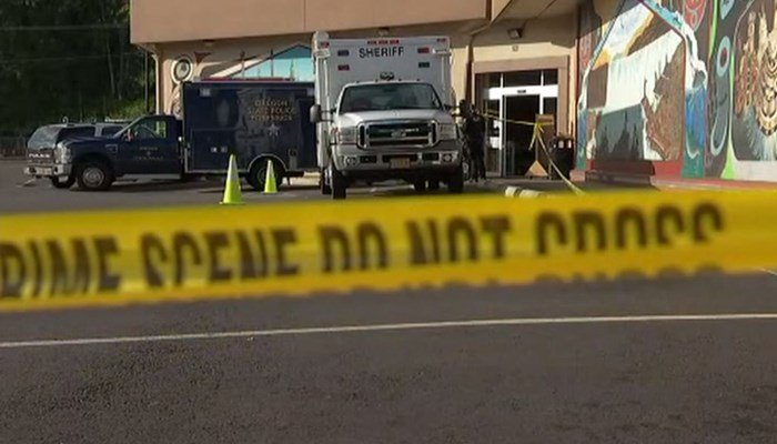 Man holding human head stabs worker at grocery store