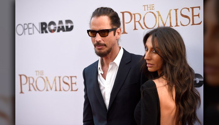 "Chris Cornell, left, and wife Vicky Karayiannis arrive at the U.S. premiere of ""The Promise"" at the TCL Chinese Theatre on April 12 in Los Angeles. Cornell has died at age 52. (Photo by Chris Pizzello/Invision/AP)"