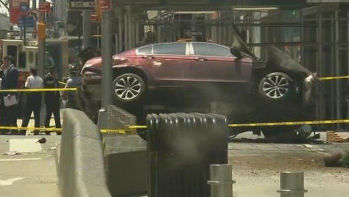 This tilted red sedan drove into a crowded Times Square injuring several and killing one. (Source: CNN)