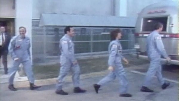 The Challenger crew makes their way to the launch pad. (Source: CNN)