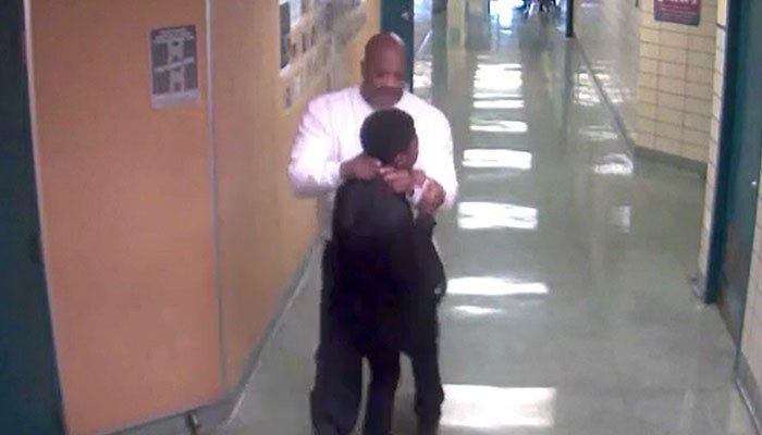 A lawyer says his client was just doing his job when he lifted a student by the neck. (Source: WTA/CNN)