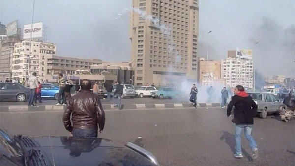 Tear gas canisters are fired at the crowds protesting in Egypt. (Source: CNN)