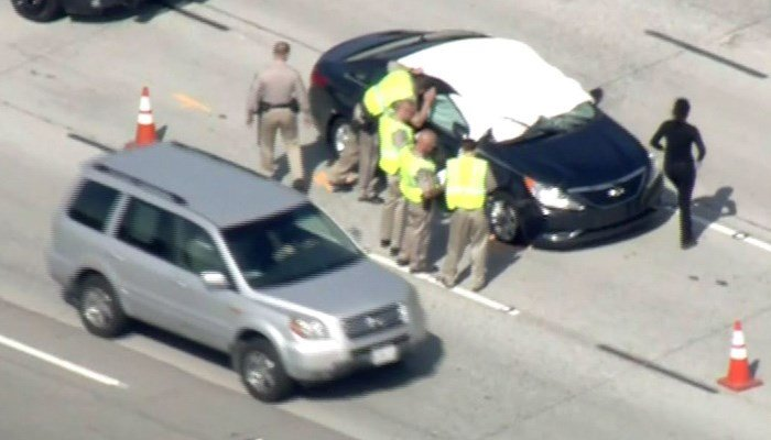 A tire came loose from a car on the freeway, bouncing into a car coming from the opposite direction, killing the driver instantly. (Source: KCAL/KCBS/CNN)