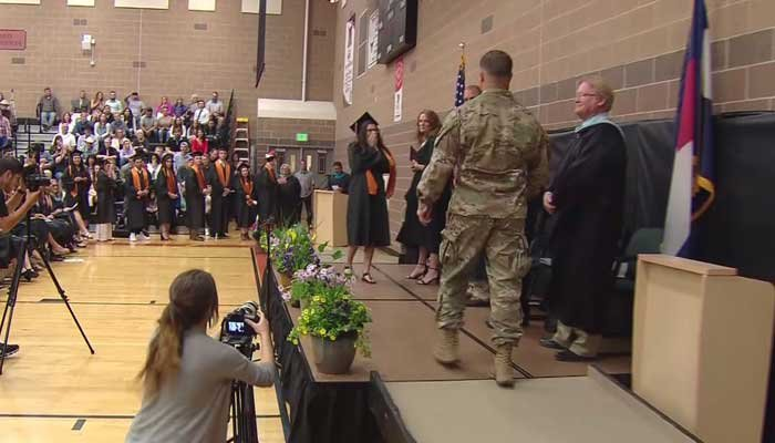 Carlee hadn't seen her brother Christopher since he was deployed to Afghanistan last July. He surprised her as she graduated. (Source: KCNC/CNN)