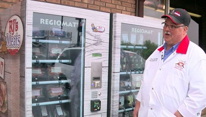 Butcher Rick Reams admires his new vending machines just outside the door to his butcher shop. (Source: WCCO/CNN)