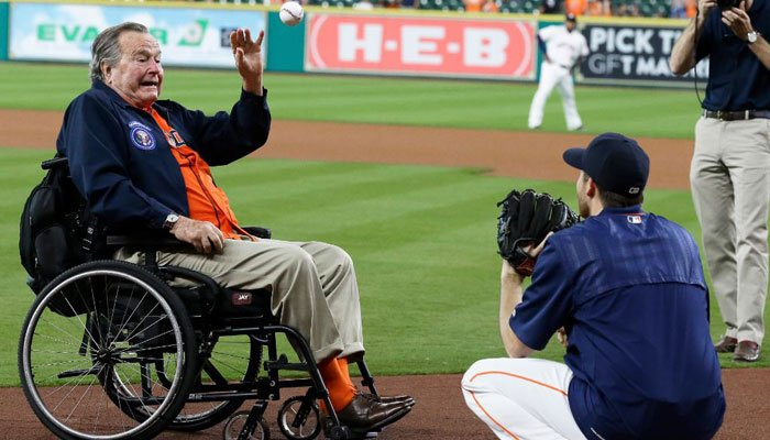 Former President George H.W. Bush throws out the ceremonial first pitch to Houston Astros starting pitcher Collin McHugh before the Astros' baseball game against the Kansas City Royals on Tuesday, April 12, 2016, in Houston. (Source: AP Photo/Pat Sullivan