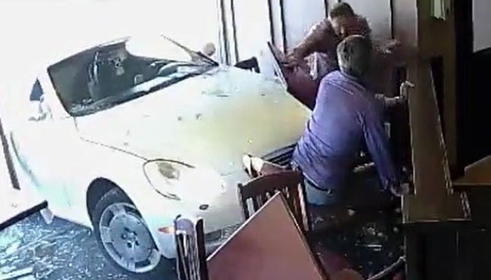 A psychic didn't see the future in which a car hit him while he was dining in a restaurant. (Source: KNXV/CNN)