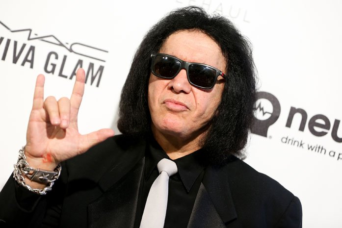 Gene Simmons wants you to rock on, but you may have to pay for it. (Source: Rich Fury/Invision/AP)