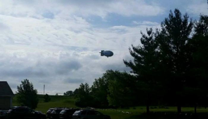 The blimp crashed into an open field outside the golf course. (Source: Alex Grimm/Twitter)