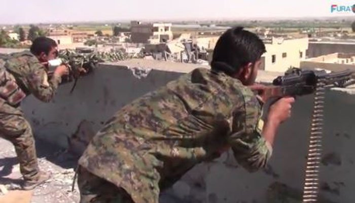 Backed forces in Syria breach Raqqa's old city wall