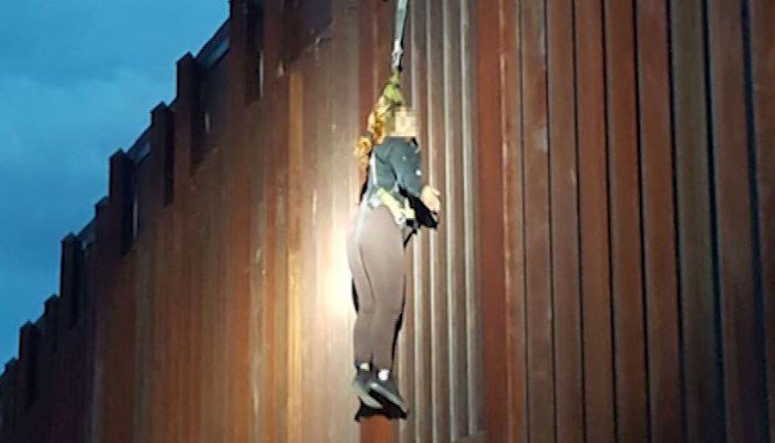 Smugglers abandon Mexican woman found dangling from border fence
