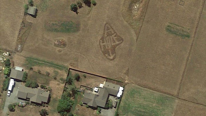 A person scrolling the globe with Google Maps found a message in Sequin, WA: 'A HOLE.' (Source: Google Earth)