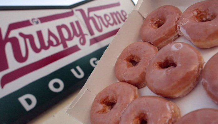You have to buy a full price dozen first, but it's still pretty sweet. (Source: Krispy Kreme via CNN)