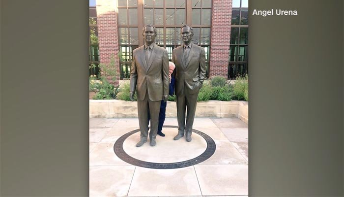 A photo of Clinton standing between the statues was taken at the George W. Bush Presidential Library. (Source: Angel Urena/CNN)