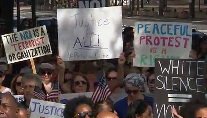 Demonstrators took to the streets Saturday in Washington to protest an NRA recruitment ad. (Source: WJLA/CNN)