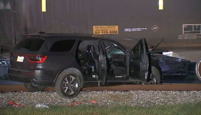 Police are looking at alcohol as a factor in the crash that wedged the vehicle underneath the train. (Source: KTRK/CNN)