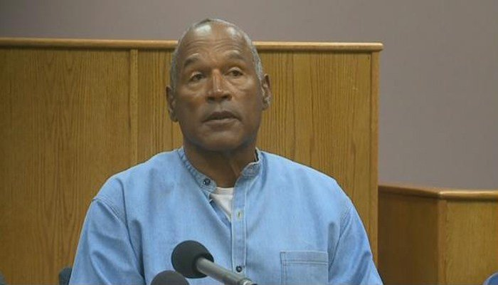 O.J. Simpson listens to his Nevada parole hearing. (Source: CNN)
