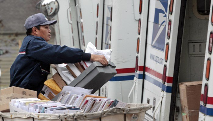 The USPS receives almost a million packages from foreign countries. If this bill passes, foreign posts will be required to provide electronic data that would help catch the dealers. (Source: AP/Elaine Thom