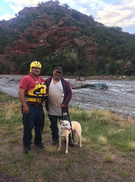 The Fremont County Sheriff's Office showed the man alongside his rescuer and 'Petey' safe on shore. (Source: Fremont Co. Sheriff's Office/Facebook)