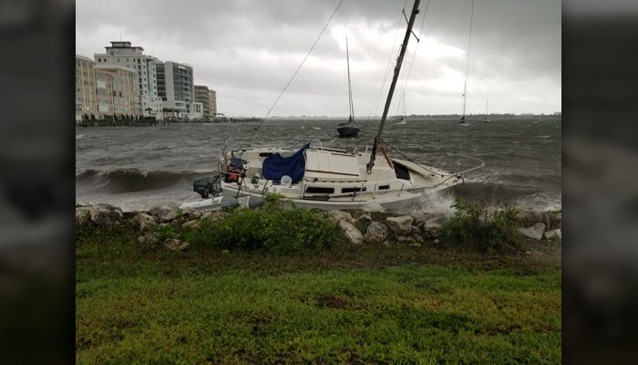 A sailboat was pushed ashore as a result of Tropical Storm Emily's strong surf. (Source: WWSB)