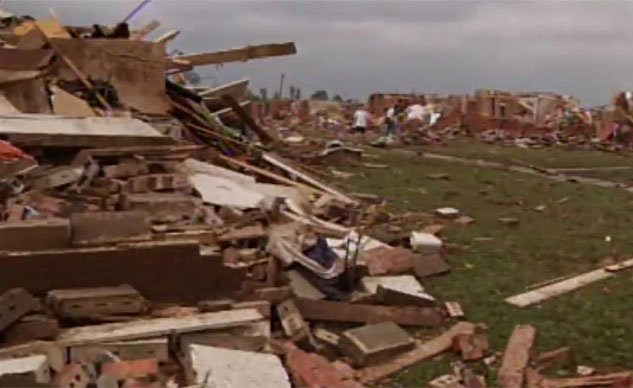 Residents picked through their totaled homes and apartments searching for anything salvageable after a wedge tornado, about a mile wide, tore a path of devastation through Tuscaloosa, AL. (Source: WBRC)