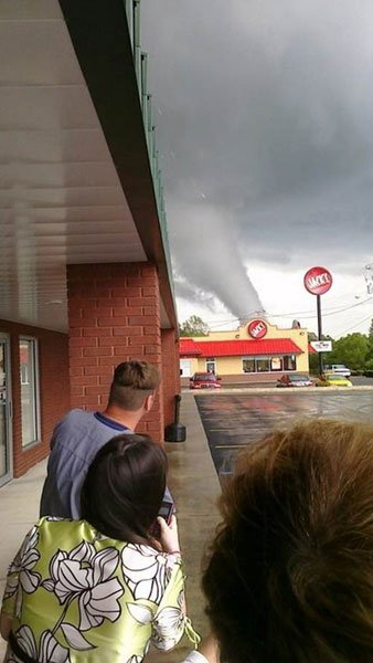 People watch as a tornado razes Cullman. (Source: WSFA)