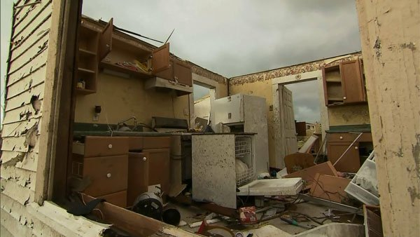 This home lost its roof in the storm. (Source: CNN)