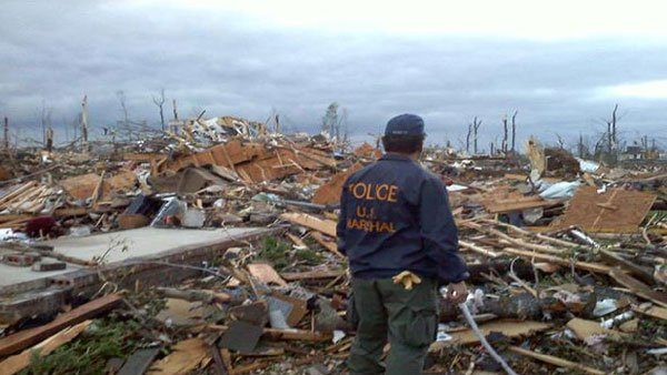 Police look over demolished properties. Homes were ripped off of their slabs and thrown through the air. (Source: WSFA)