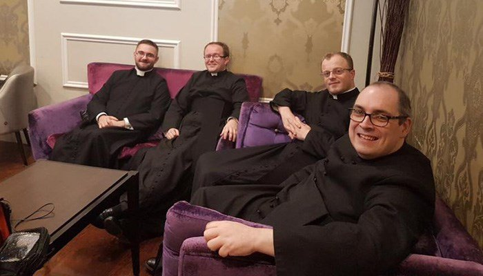 The seminary students wait for a TV appearance about being in a joke come to life. (Source: Archdiocese of Cardiff/Facebook)
