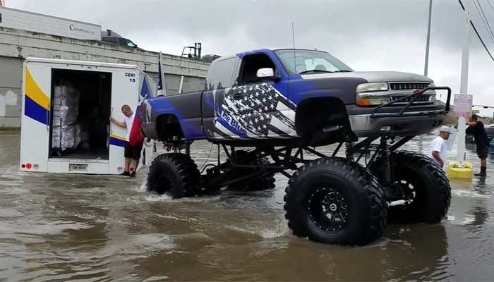 A Texas man is using his friend's monster truck to help those stranded by flood waters. (Source: KPRC/CNN)