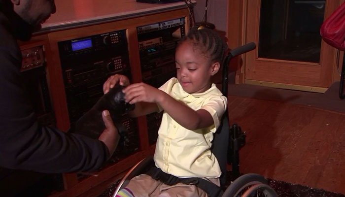 Atlanta rapper Big Boi gave a service puppy to a girl who was paralyzed in a bounce house shooting. (Source: WSB/CNN)