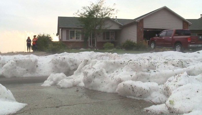 About 2 feet of ice accumulated in 15 minutes. (Source: KDVR via CNN)