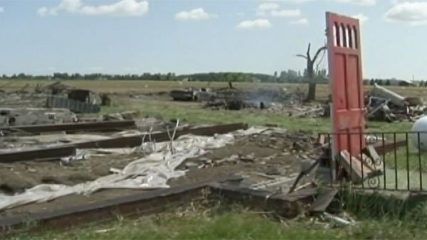 A door and a concrete slab are all that's left standing of a home that was struck by a tornado in Mississippi. (Source: WLBT)