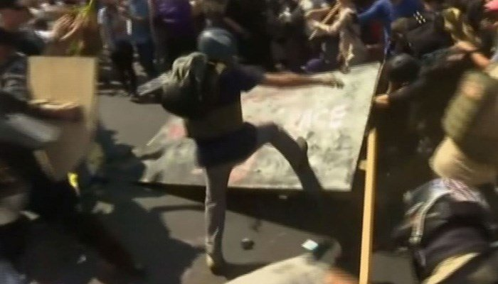 Protesters clash in Charlottesville, VA. (Source: CNN)