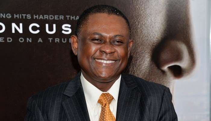 Dr. Bennet Omalu, a forensic pathologist, identified the brain disease CTE in multiple football players, and was played by Will Smith in a movie about his life. (Source: AP/Evan Agostini/Innvision)