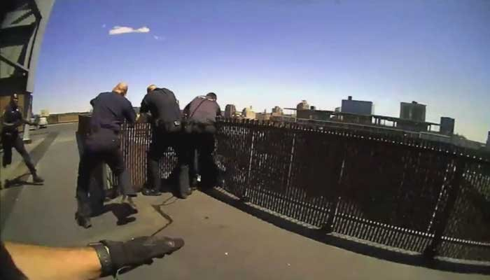 Police officers scrambled to save a woman who planned to jump off the ledge of roof of a 16-story building. (Source: WFSB/CNN/New Haven Police)