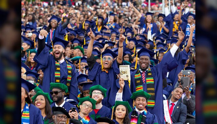 Graduate students cheer as then-President Barack Obama delivers Howard University's commencement speech during the 2016 Howard University graduation ceremony in Washington, DC, May 7, 2016. ( AP Photo/Jose Luis Magana)