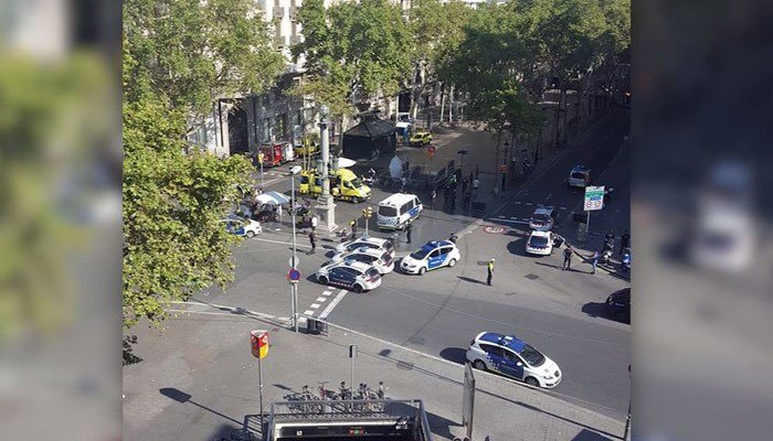 The crash scene in Barcelona is shown with police cars. (Source: @Vil_Music/CNN)