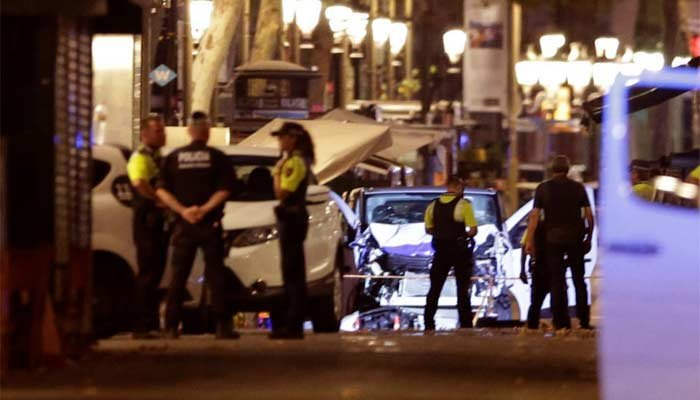 Police officers stand next to the van involved on an attack in Las Ramblas in Barcelona, Spain, Thursday, Aug. 17, 2017. (Source: AP Photo/Manu Fernandez)