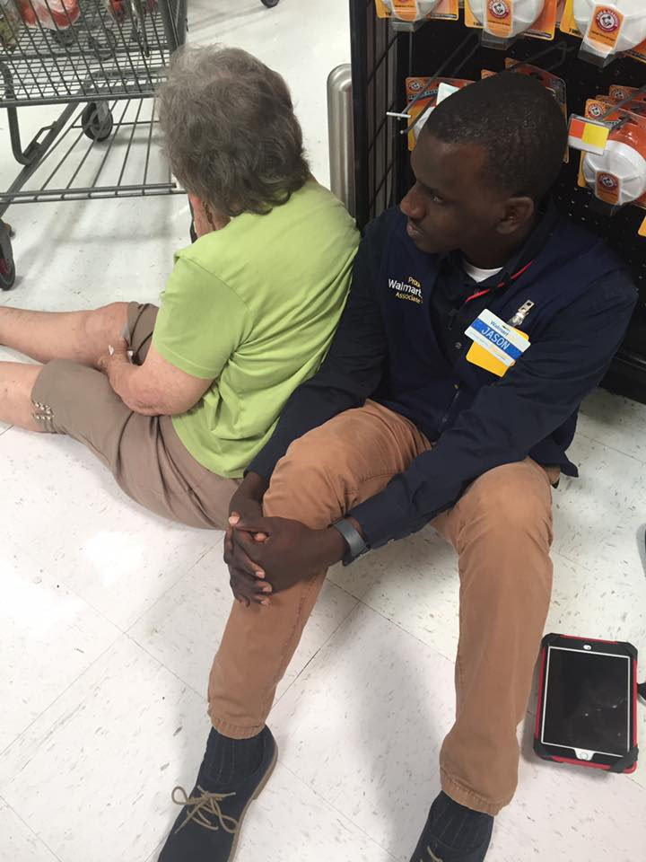 A manager at a Georgia Walmart literally got down on the floor to hold up a customer who had fallen. (Source: Facebook/Brittany McKee)