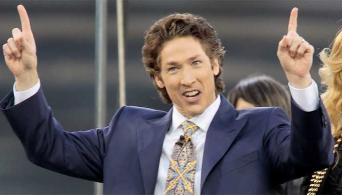 """This 2010 file photo shows pastor Joel Osteen at Dodger Stadium during his """"A Night of Hope"""" in Los Angeles. (Source: AP Photo/Richard Vogel, File)"""