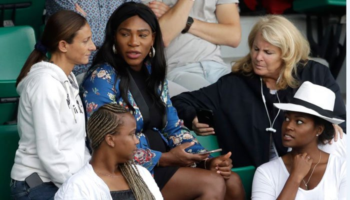 Serena Williams, center top, talks to guests as her sister Venus Williams plays during a third round match of the French Open on June 2, 2017, in Paris. (Source: AP Photo/Petr David Josek)