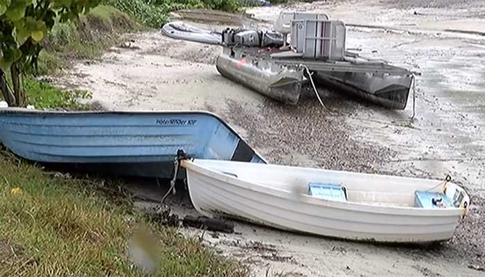 Water has been receding on Sarasota Bay and around the Suncoast, sinking boats and docks into the mud. (Credit: ABC7 Staff)